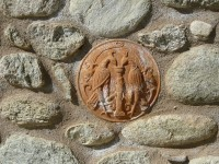 Clay ornament on a stone wall