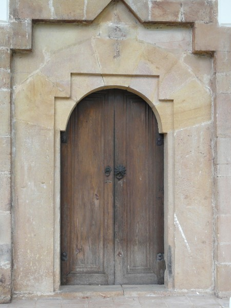 Wooden door in a stone carved wall
