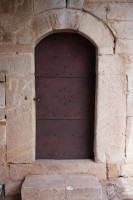 Iron door in a stone wall