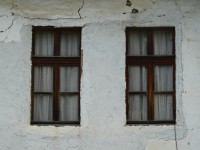 Two windows, cracked wall