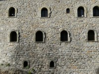 Windows on a fortress wall