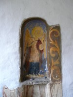 Angel painted in a window-shaped recess