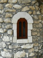 Small arch window on a stone wall