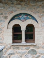 Window with painted birds in the arch