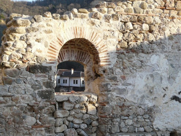 Traditional house seen through a fortress window