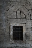 Stone window with iron bars