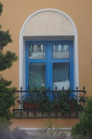 Blue window on a yellow wall