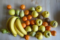 Fruit mix with bananas, apples, pears, tangerines and kiwifruit