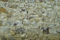 Old stone wall with crack